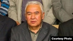 FILE - Nurmuhammad Tohti, sitting at a scholarly gathering in Urumqi, capital of Xinjiang, China. (Abduweli Ayup)