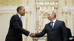 Kuzatuvchilarga ko'ra, hozir Rossiyaning Eronga oid qarashi AQSh pozitsiyasiga har qachongidan yaqin. Suratda Rossiya prezidenti Vladimir Putin (o'ngda) AQSh prezidenti Barak Obama bilan.