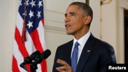 U.S. President Barack Obama announces executive actions on U.S. immigration policy during a nationally televised address from the White House in Washington, Nov. 20, 2014.