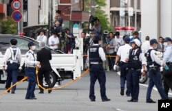Police officers work at the scene where a man wielding a knife attacked a group of schoolchildren in Kawasaki, near TokyoMay 28, 2019.
