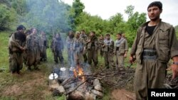 Kurdistan Workers Party (PKK) fighters rest around a fire in northern Iraq in this May 14, 2013, file photo.