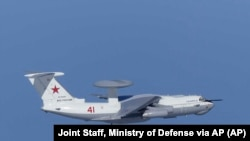 This image released by Joint Staff, Ministry of Defense, shows Russian A-50 airborne early warning and control aircraft flying near the Korean-controlled island called Takeshima in Japanese Tuesday, July 23, 2019.
