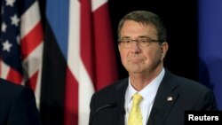 FILE - U.S. Secretary of Defense Ash Carter listens during a news conference in Tallinn, Estonia, June 23, 2015.