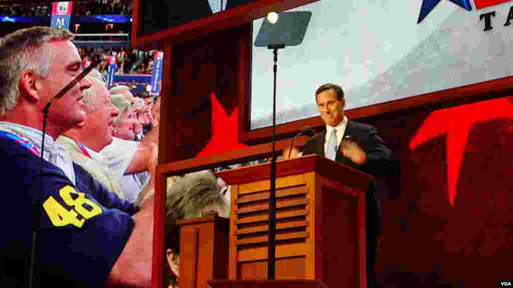Former candidate for the Republican Presidential nomination, Rick Santorum, shows his support for his party and Mitt Romney during his speech.