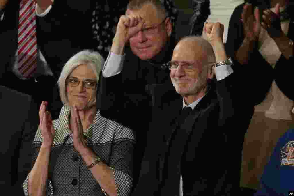 Alan Gross, who was recently released from prison in Cuba, acknowledges applause during President Barack Obama's State of the Union address before a joint session of Congress, Jan. 20, 2015.