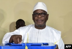 FILE - Mali's incumbent president, Ibrahim Boubacar Keita, votes in Bamako in the runoff election Aug. 12, 2018.