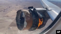 "In this image taken from video, the engine of United Airlines Flight 328 is on fire after after experiencing ""a right-engine failure"" shortly after takeoff from Denver International Airport, Saturday, Feb. 20, 2021, in Denver, Colo. (Chad Schnell via AP)"