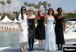 "FILE - 71st Cannes Film Festival - Photocall for the film ""355"" - Cannes, France May 10, 2018. Fan Bingbing, Marion Cotillard, Jessica Chastain, Penelope Cruz and Lupita Nyong'o pose on a pier."