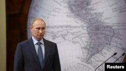 FILE - Russian President Vladimir Putin at event in St. Petersburg, June 5, 2014.