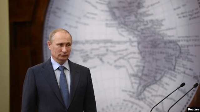 FILE - Russian President Vladimir Putin at event in St. Petersburg, June 5, 2014.