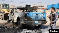 Hiện trường sau một vụ đánh bom xe ở phía bặc thủ đô Baghdad.