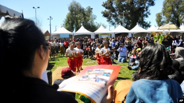The crowd is watching a traditional dance during the Cambodian Culture Festival at MacArthur Park, Long Beach, California.