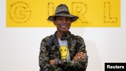 "Pharrell Williams poses during the opening of the exhibition ""GIRL"" at the Galerie Perrotin in Paris, France, May 26, 2014."