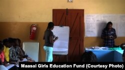 Gloria Kotente Mumeita, a Maasai medical student at the University Of Nairobi School Of Medicine in Kenya conducts a mentoring workshop for Maasai students in the Kajiado district of Kenya, thanks to the Maasai Girls Education Fund.