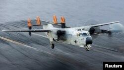 FILE - A C-2A Greyhound logistics aircraft lands on the flight deck of the aircraft carrier USS Harry S. Truman, Sept. 30, 2015.