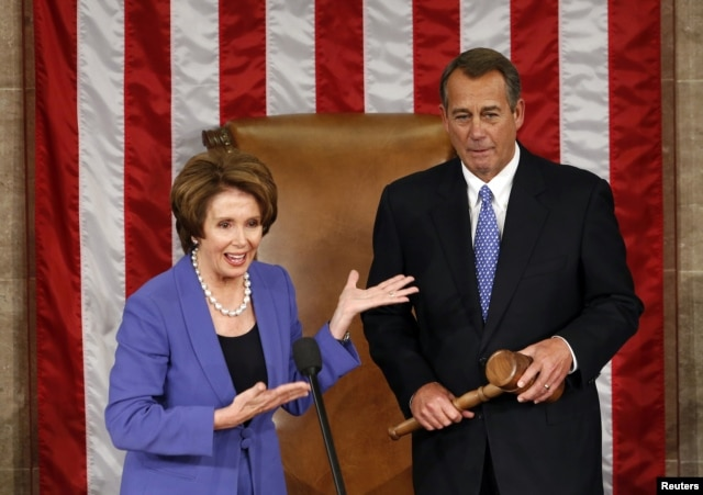 Democratic leader Nancy Pelosi (L) introduces Speaker of the House John Boehner to speak after Boehner's re-election during the first day of the 113th US Congress in the Capitol in Washington, January 3, 2013.