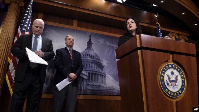 Sen. Kelly Ayotte (R), accompanied by Sen. John McCain (L), and Sen. Lindsey Graham, speaks during a news conference on Capitol Hill in Washington, Jan. 21, 2016, criticizing the Iran nuclear deal.