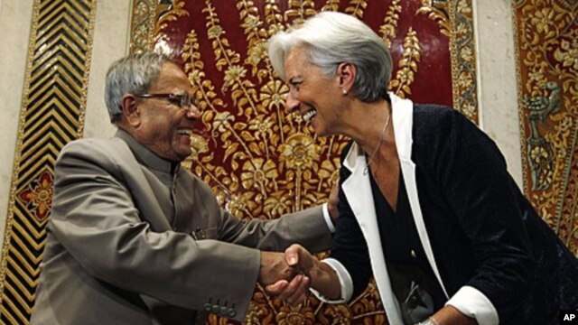 Indian Finance Minister Pranab Mukherjee greets his French counterpart Christine Lagarde in New Delhi, India, Tuesday, June 7, 2011