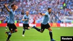 Luis Suarez et ses coéquipiers fête son 2e but contre la Russie, lors du Mondial 2018, le 25 juin 2018.