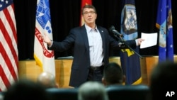 FILE - U.S. Defense Secretary Ashton Carter delivers a speech to U.S. troops at Camp Arifjan, Kuwait, February 2015.