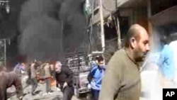 This image taken from video obtained from Ugarit News, which has been authenticated based on its contents and other AP reporting, shows smoke and fire after a fighter jet crashed into a suburb of Damascus, Syria, Feb. 20, 2013.