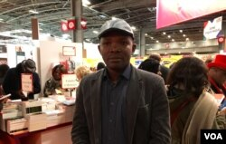 Beninese publisher Koffi Attedi thinks French can thrive without Macron's language plan. (L.Bryant/VOA)