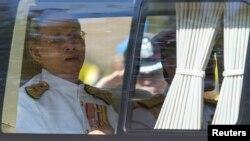 Thailand's King Bhumibol Adulyadej arrives for Coronation Day at Klai Kangwon Palace, Hua Hin, Prachuap Khiri Khan province, Thailand, on May 5, 2014.