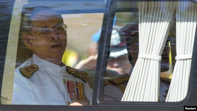 Thailand's King Bhumibol Adulyadej arrives for Coronation Day at Klai Kangwon Palace, Hua Hin, Prachuap Khiri Khan province, Thailand, on May 5, 2014.
