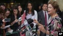 President Dilma Rouseff speaks about proposed budget cuts in Brasilia. The government is seeking to reduce a deficit in the 2016 budget. The government has also proposed tax increases on financial transactions. (AP Photo/Eraldo Peres)