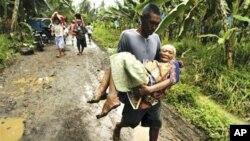菲律宾水灾时有发生。图为今年1月该国南部导致至少53人死亡的洪灾
