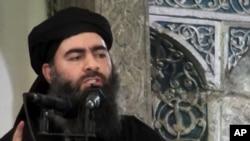 Hình thủ lĩnh Nhà Nước Hồi Giáo Abu Bakr al-Baghdadi phát biểu tại một nhà thờ Hồi giáo ở Mosul, ngày 5 tháng 7, 2014. Giới chức Iraq loan tin ông al-Baghdadi, đã bị thương trong một cuộc không kích.