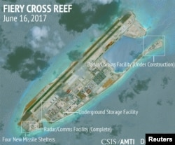 FILE - Construction is shown on Fiery Cross Reef in the Spratly Islands, the disputed South China Sea, in this June 16, 2017, satellite image released by CSIS Asia Maritime Transparency Initiative at the Center for Strategic and International Studies (CSIS).