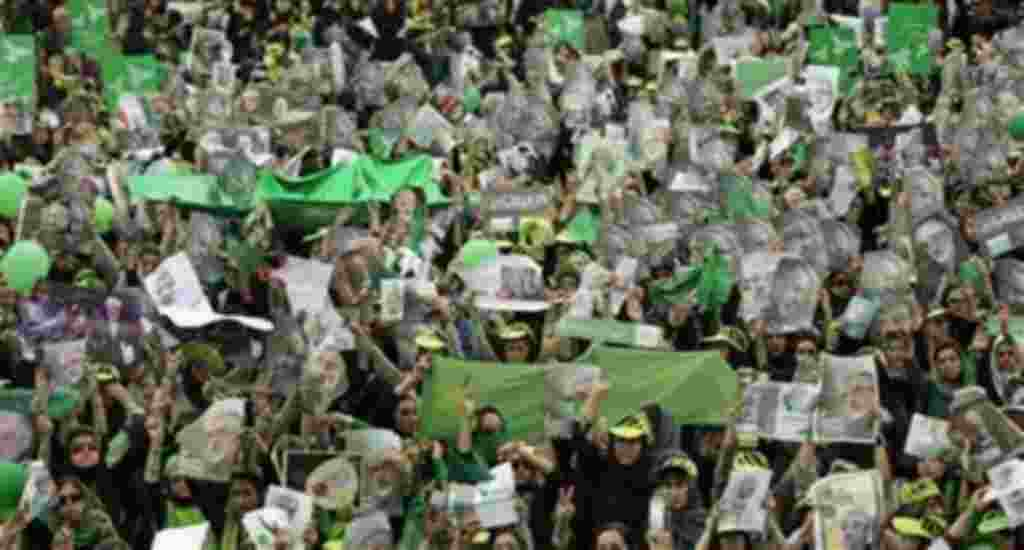 Supporters of main challenger and reformist candidate Mir Hossein Mousavi, many carrying posters of him, attend an election rally at the Heidarnia stadium in Tehran, Iran, Tuesday, June 9, 2009. (AP Photo / Ben Curtis)