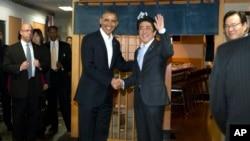 President Barack Obama and Japanese Prime Minister Shinzo Abe shake hands before having dinner at Sukiyabashi Jiro sushi restaurant in Tokyo, April 23, 2014.