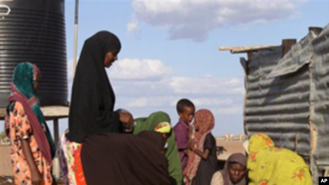Women fetch water at the site of a borehole in Dertu, Kenya. The microbes that cause diarrhea spread through contaminated food and water, or through poor hygiene and sanitation.