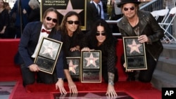 FILE - Maná members Sergio Vallin, from left, Juan Calleros, Alex Gonzalez and Fher Olvera pose together after the Mexican rock band received a star on the Hollywood Walk of Fame, Feb. 10, 2016, in Los Angeles.