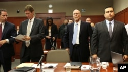 George Zimmerman, far right, stands for the judge arrival with, from left, assistant state attorney John Guy, defense attorney Mark O'Mara and co-defense counsel Don West in Seminole Circuit Court in Sanford, Florida, June 24, 2013.