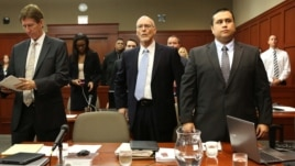George Zimmerman, far right, stands for the judge's arrival with, from left, defense attorney Mark O'Mara and co-defense counsel Don West in Seminole Circuit Court in Sanford, Florida, June 24, 2013.