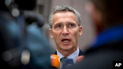 FILE - NATO Secretary-General Jens Stoltenberg is seen speaking at a press conference in Brussels.