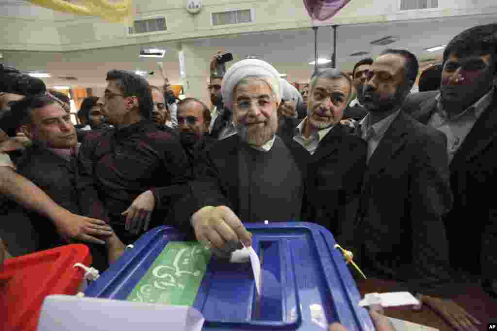 Iranian presidential candidate Hasan Rowhan casts his ballot at a polling station in downtown Tehran, June 14, 2013.