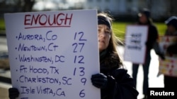 FILE - Gun control activists rally in front of the White House, Washington, Jan. 4, 2016.