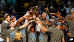 The members of the Golden State Warriors celebrate after winning the NBA Finals against the Cleveland Cavaliers in Cleveland, Wednesday, June 17, 2015.