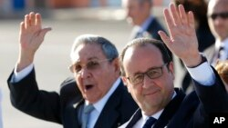 France's President Francois Hollande, right, and Cuba's President Raul Castro wave to reporters during Hollande's farewell ceremony at Jose Marti International Airport in Havana, May 12, 2015.