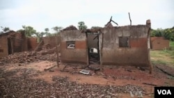 FILE - Deserted, razed villages line more than 100 kilometers of road south of Bossangoa.
