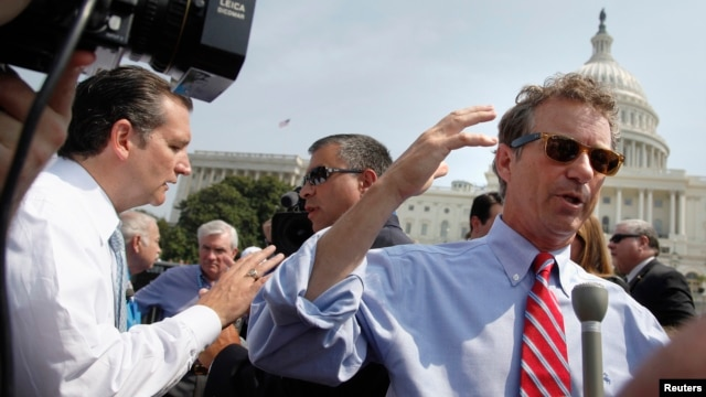 Republican U.S. Senators Ted Cruz (L) and Rand Paul (R) talk to reporters as they arrive to speak at an anti-'Obamacare' rally on the west lawn of the U.S. Capitol in Washington, September 10, 2013.