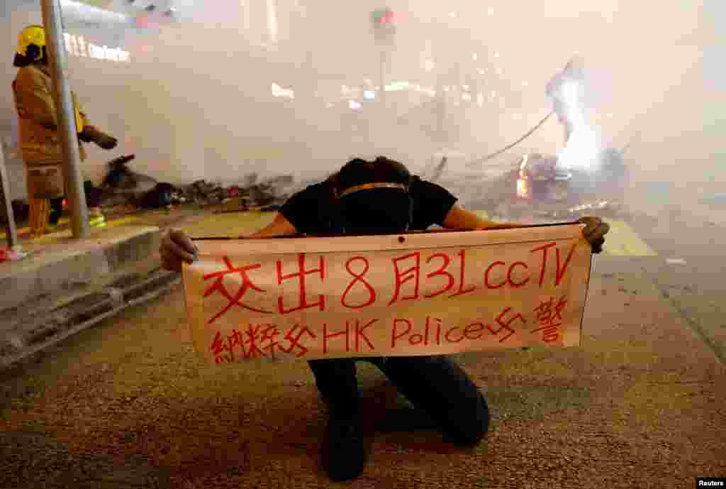 A protester holds a banner during a demonstration in Mong Kok district in Hong Kong, China.