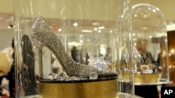 "A Jimmy Choo shoe, glass slipper from ""Cinderella,"" is for sale exclusively at Saks Fifth Avenue in New York, March 9, 2015."