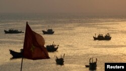 FILE - Fishing boats are seen on bay of Ly Son islands of Vietnam's central Quang Ngai province April 10, 2012.