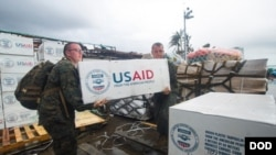 U.S. Military help distribute aid after last year's hurricanes in Guatemala.
