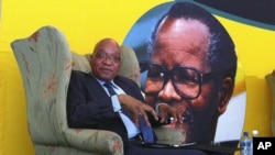 South African president Jacob Zuma, in front of a portrait of former African National Congress president Oliver Tambo, addresses foreign correspondents at a breakfast in Johannesburg, Oct. 29, 2012.